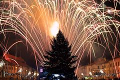 New Year's Eve fireworks. Behind  Christmas tree Stock Photo