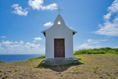 Church on the top of mountain with blue sky and sea view royalty free stock photo