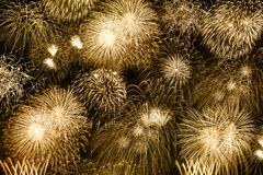 New Year`s Eve fireworks gold golden background years year firew stock photo