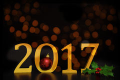 2017 new year`s eve in golden numbers with christmas decoration royalty free stock photography