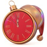 New Year`s Eve last hour countdown Christmas ball clock red. New Year`s Eve last hour countdown Christmas ball clock midnight time Santa Claus hat red golden Stock Photos