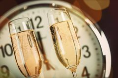 New year`s eve. Champagne new year`s day clock midnight celebration symbol royalty free stock photo