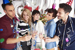 New Year's eve at the office. Company workers celebrating new year together Stock Images