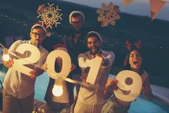 New Year`s Eve outdoor pool party stock photos
