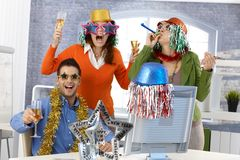 New year's eve party in office. Team party with funny accessories Stock Photo