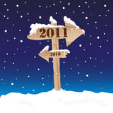 New Year's Eve sign. A wooden sign showing the way to 2011 from 2010. New Year's eve concept Royalty Free Stock Photos