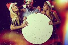 New Year's Eve. Three young people, having fun at New Year's Eve Party, blowing whistles and holding cardboard blank circle Stock Image