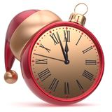 New Year`s Eve time Christmas ball alarm clock Santa hat red Royalty Free Stock Images