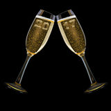 New Year`s Eve 2017. Two champagne glasses with the year 2017, isolated on black Stock Photography