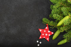 New Year`s festive decorations with fluffy fir branches with young green cones, with Christmas tree decorations on a Stock Photo