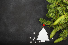 New Year`s festive decorations with fluffy fir branches with young green cones, with Christmas tree decorations on a Royalty Free Stock Photos