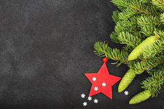 New Year`s festive decorations with fluffy fir branches with young green cones, with Christmas tree decorations on a Royalty Free Stock Image