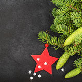 New Year`s festive decorations with fluffy fir branches with young green cones, with Christmas tree decorations on a Royalty Free Stock Photography