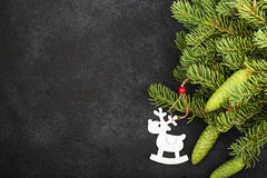 New Year`s festive decorations with fluffy fir branches with young green cones, with Christmas tree decorations on a Stock Photography