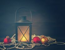 New Year`s fir tree toys, glass spheres, cones and Christmas lamp  on a wooden background. Royalty Free Stock Images