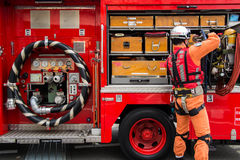 The New Year's Fire Review Kanagawa, Japan. Kanagawa, Japan - January 5: Unidentified male firefighter demonstrates the rescue tools at Nissan Stadium on January Royalty Free Stock Photography