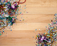 New Year's: Fun New Year's Eve Background. Background series good for New Year's Eve - with confetti, champagne, etc. and lots of copyspace on a wooden table Royalty Free Stock Photo
