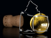 New Year's gala. Close up of champagne cork on black background Stock Image