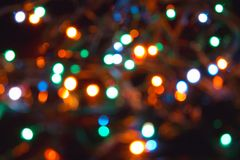 New Year's garlands. Christmas garland on a tree, out of focus the image Stock Images