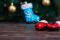 A glass of champagne under the Christmas tree on a dark background royalty free stock images