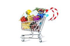 New Year`s gifts in a shopping trolley close-up isolated Royalty Free Stock Photography