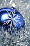 New Year's glass sphere of dark blue color 3. New Year's glass sphere of dark blue color with a pattern on a background of a christmas tinsel Stock Photos