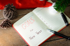 New Year's goals with colorful decorations. New Year's goals are resolutions or promises that people make for the New Year to make their upcoming year better Royalty Free Stock Image