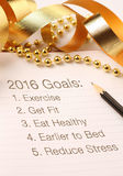 2016 New year's goals. New Year's goals with gold color decorations. New Year's goals are resolutions or promises that people make for the New Year to make royalty free stock images