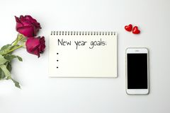 New Year' S Goals Words On Notebook With Roses And Smart Phone Stock Image