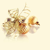 New Year's gold ball with a bow. Royalty Free Stock Photography