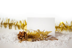 New Year's golden ball on snow with a tape. Stock Photos