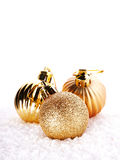 New Year's golden balls on snow. Royalty Free Stock Photo