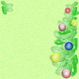 New Year's green background with fir-tree branches. And Christmas tree decorations Royalty Free Stock Photos