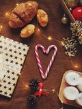 New Year`s holiday still life with a book and a cup of cocoa. Cozy and warm Christmas photo with a book, a cocoa mug, gifts and a heart-shaped candy royalty free stock images