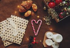 New Year`s holiday still life with a book and a cup of cocoa. Cozy and warm Christmas photo with a book, a cocoa mug, gifts and a heart-shaped candy stock images