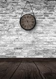 New Year`s Hours. Round wooden clock on the old brick wall, bokeh effect, celebratory, magic light, New Year, Christmas. Brick wall background, antique clock stock photo
