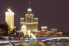 Evening view on the high-rise building of the Kotelnicheskaya em Royalty Free Stock Photos
