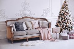 New Year`s interior with a beautiful decorative tree and gift boxes. New Year`s interior with a beautiful decorative Christmas tree Royalty Free Stock Image