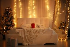 New Year`s interior in bedroom at home Christmas background Stock Image