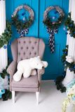 New Year`s interior. Christmas decorations. Luxury , bright, clean bright beautiful home interiors. Armchair with a bear Stock Photos