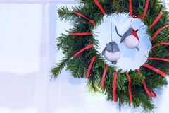 New year`s interior. Christmas wreath. Toy birds bullfinches royalty free stock images
