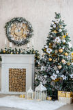 New Year's interior with a fireplace, a fur-tree and candles Royalty Free Stock Photography