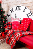 New Year`s interior room. Christmas tree decorated with colorful balloons and gifts lie on the floor. Christmas and New Year backg Stock Photography