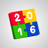 New Year's jigsaw puzzles 2016. Multicolor New Year's jigsaw puzzles with white digits on gray background. New Year 2016 concept Royalty Free Stock Photography