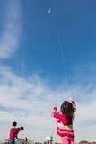 New Year's Kite Festival Kanagawa, Japan. Kanagawa, Japan - January 13: Unidentified children fly Kites in the New Year's Kite Festival at Nissan Stadium on Royalty Free Stock Images