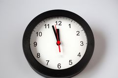 New Year& x27;s at midnight - clock at twelve o& x27;clock with holiday li Royalty Free Stock Images