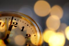 New Year& x27;s at midnight - clock at twelve o& x27;clock with holiday li Stock Photo