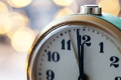 New Year's at midnight - clock at twelve o'clock with holiday lights Royalty Free Stock Photography