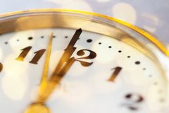 New Year& x27;s at midnight - clock at twelve o& x27;clock with holiday li Stock Photography