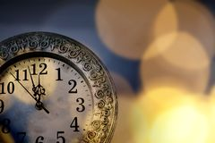 New Year& x27;s at midnight - clock at twelve o& x27;clock with holiday li Royalty Free Stock Photo